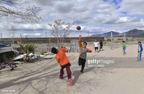 Mexican children who live near to the metal fence between their country and the United States play football in Puerto Anapra Chihuahua state on...