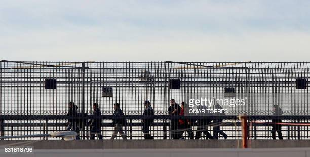 Mexican citizens return to their country through a pedestrian bridge at the San Ysidro entry point in the MexicanUS border 24 January 2006 Hundreds...