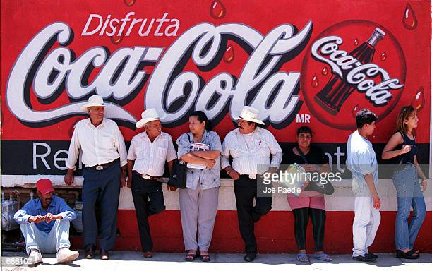 Mexican citizens wait in line to vote in the Mexican presidential election July 2 2000 in Ciudad Juarez Mexico Sixtyfour polling places were set up...