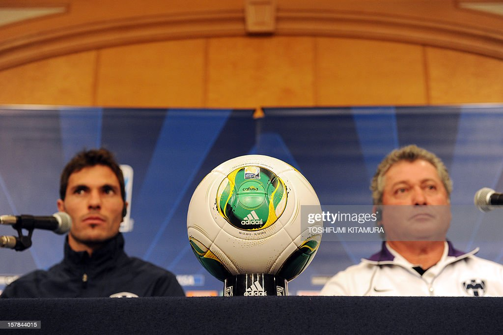 Mexican club team Monterrey captain and defender Jose Maria Basanta (L) and head coach Victor Vucetich (C) sit behind the official ball during the team's press conference at a hotel in Nagoya, Aichi prefecture while participating in the FIFA Club World Cup in Japan 2012 on December 7, 2012. The ninth edition of the FIFA Club World Cup football tournament is taking place from December 6 to 16.