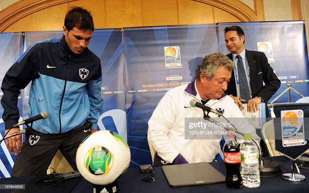 Mexican club team Monterrey captain and defender Jose Maria Basanta (L) and head coach Victor Vucetich (C) stand up after the team's press conference at a hotel in Nagoya, Aichi prefecture while participating in the FIFA Club World Cup in Japan 2012 on December 7, 2012. The ninth edition of the FIFA Club World Cup football tournament is taking place from December 6 to 16.