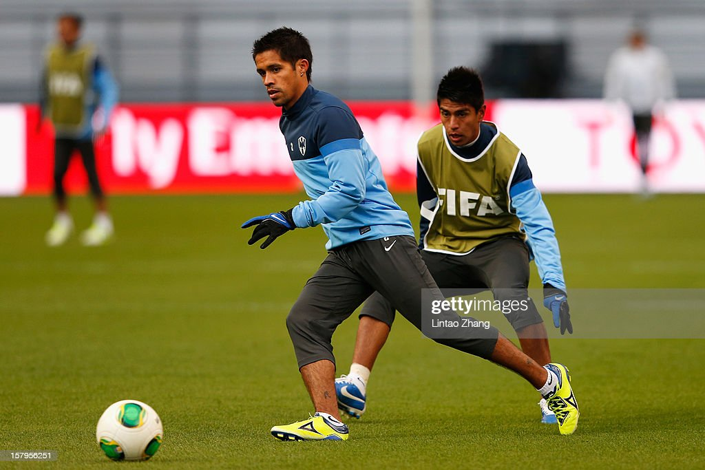 Mexican club team Monterrey defender Severo Meza (L) chases the ball during the CF Monterrey training session at Toyota Stadium on December 8, 2012 in Toyota, Japan.