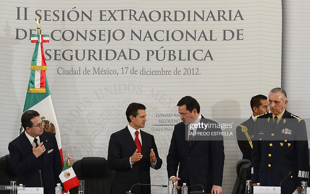 Mexican congressman Francisco Arroyo, Mexican President Enrique Pena Nieto, Mexican Interior Minister Miguel Osorio Chong and Mexican Defence Secretary General Salvador Cienfuegos are pictured during the II Session of the National Public Security Council, at the National Palace in Mexico City, on December 17, 2012. AFP PHOTO/Alfredo ESTRELLA