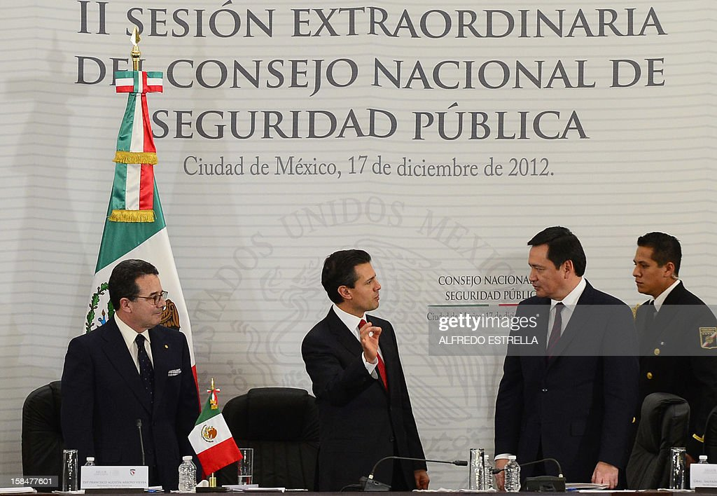 Mexican congressman Francisco Arroyo (L), Mexican President Enrique Pena Nieto and Mexican Interior Minister Miguel Osorio Chong (2-R) are pictured during the II Session of the National Public Security Council, at the National Palace in Mexico City, on December 17, 2012. AFP PHOTO/Alfredo ESTRELLA