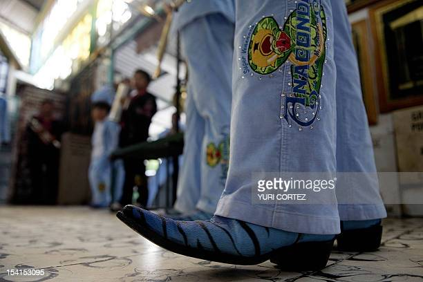 Mexican 'corridos' band 'Super Venenosa Anaconda' performs in Culiacan Sinaloa state on July 12 2011 The narcocorridos Mexico's popular songs...