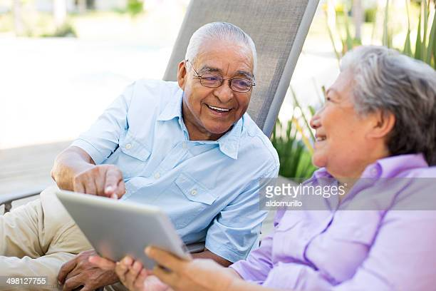 Mexican couple holding a tablet