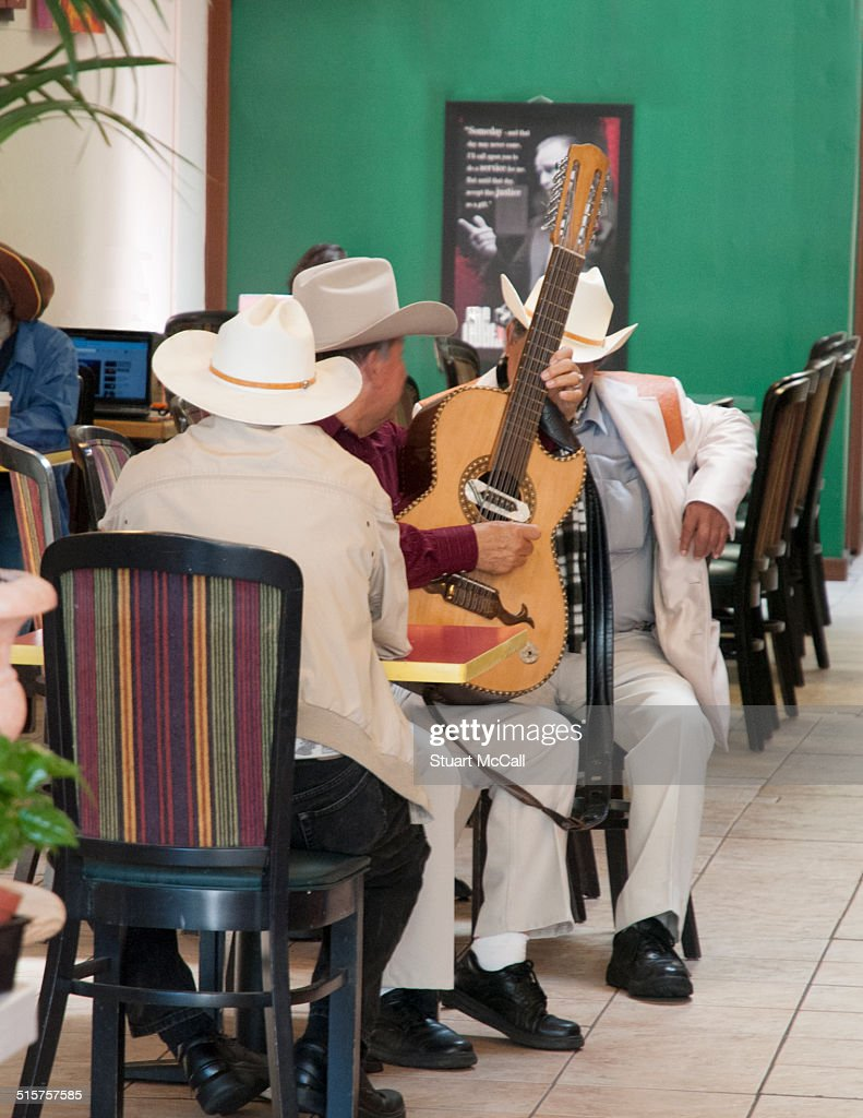 Mexican cowboy musicians in cafe