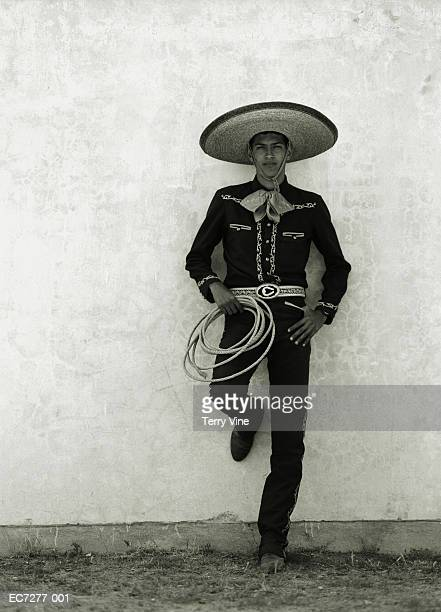 Mexican cowboy wearing hat and holding lasso (toned B&W)