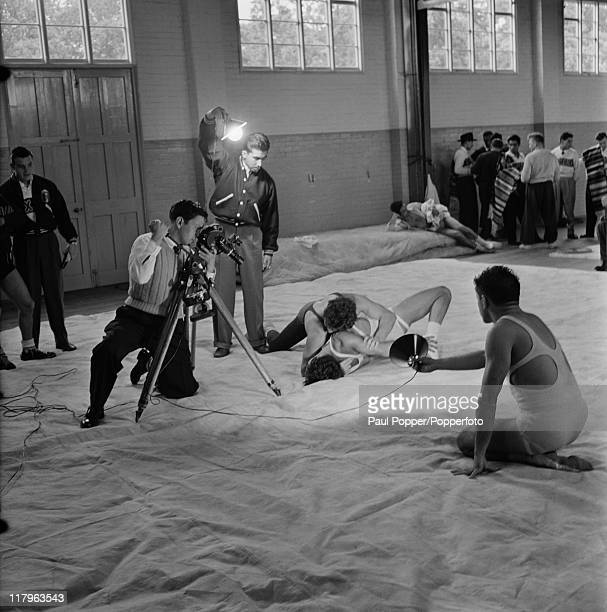 A Mexican crew filming Mexican wrestler Jose Luis Perez in training at a gym at the Olympic village in Richmond Surrey during the London Olympics 1948