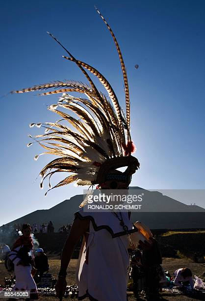 Mexican dancers in Aztec costumes perform in front of the Pyramid of the Sun in Teotihuacan Mexico during the celebrations for the Spring Equinox on...