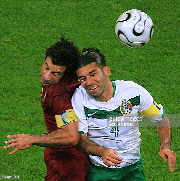 Mexican defender Rafael Marquez and Portuguese forward Luis Figo jump to head off the ball during the World Cup 2006 group D football game Portugal...