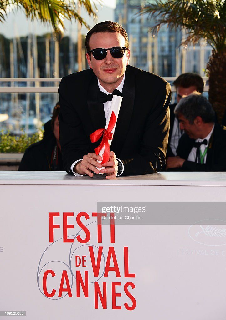 Mexican director Amat Escalante poses after being awarded with the Best Director award for the film 'Heli' at the photocall for award winners during the 66th Annual Cannes Film Festival at Palais des Festivals on May 26, 2013 in Cannes, France.