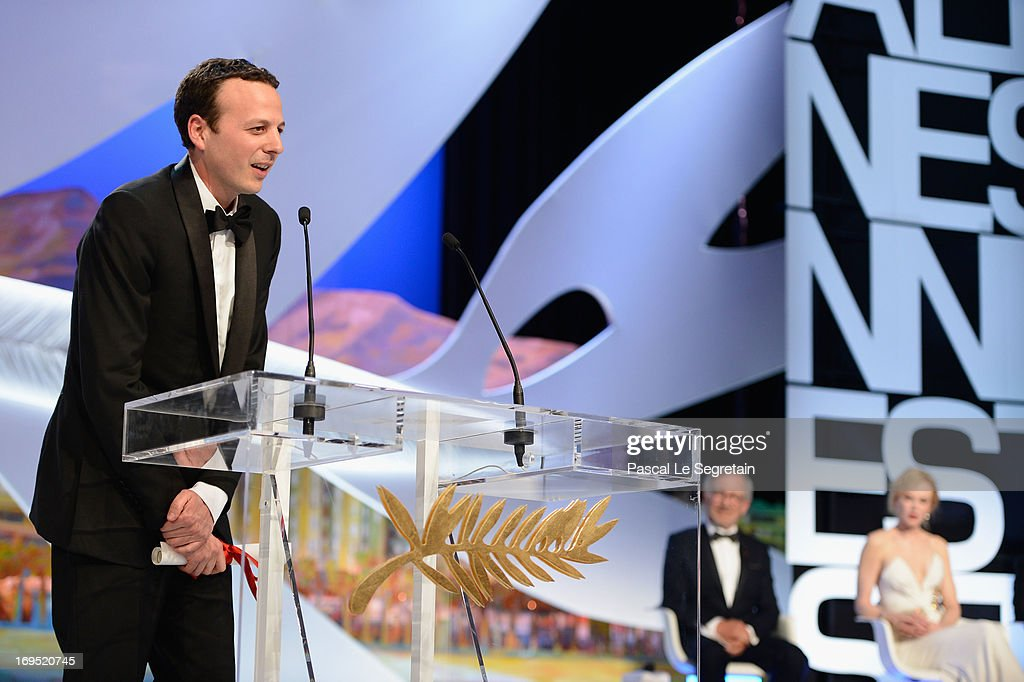 Mexican director <a gi-track='captionPersonalityLinkClicked' href=/galleries/search?phrase=Amat+Escalante&family=editorial&specificpeople=5350930 ng-click='$event.stopPropagation()'>Amat Escalante</a> poses on stage after being awarded with the Best Director award for the film 'Heli' at the'Zulu' Premiere and Inside Closing Ceremony during the 66th Annual Cannes Film Festival at the Palais des Festivals on May 26, 2013 in Cannes, France.