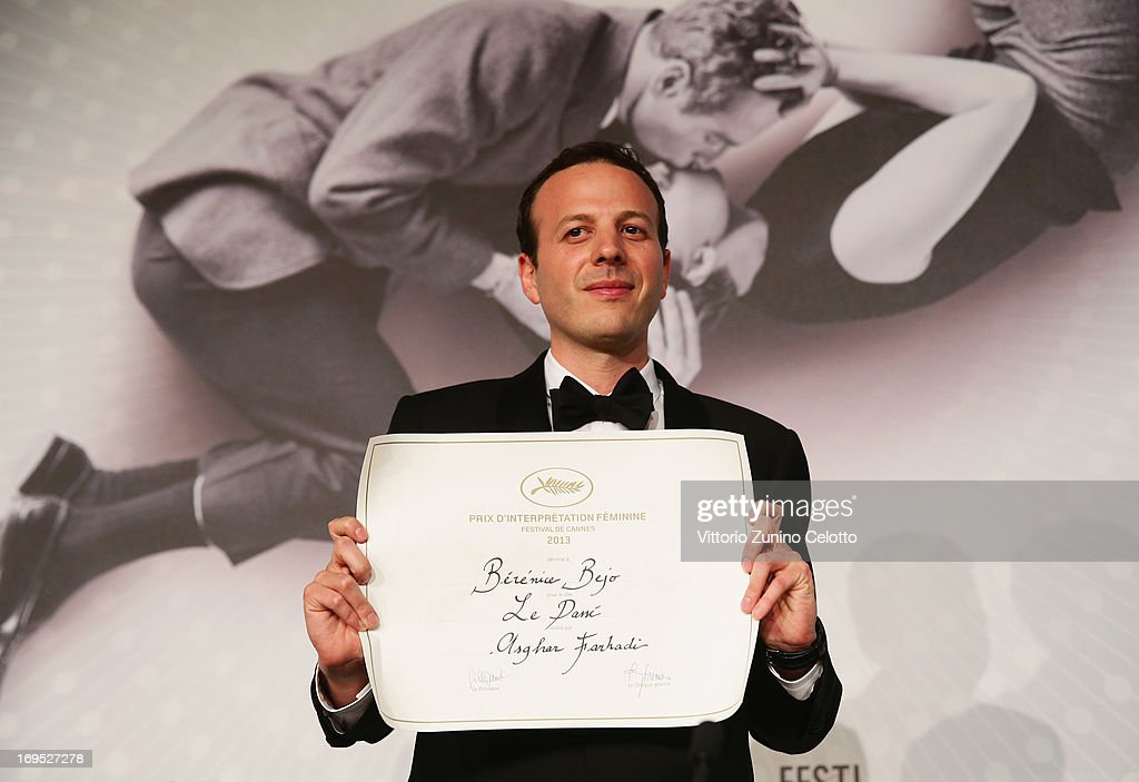 Mexican director <a gi-track='captionPersonalityLinkClicked' href=/galleries/search?phrase=Amat+Escalante&family=editorial&specificpeople=5350930 ng-click='$event.stopPropagation()'>Amat Escalante</a> poses with his price after being awarded with the Best Director award for the film 'Heli' during the Palme D'Or Winners Press Conference during the 66th Annual Cannes Film Festival at the Palais des Festivals on May 26, 2013 in Cannes, France.