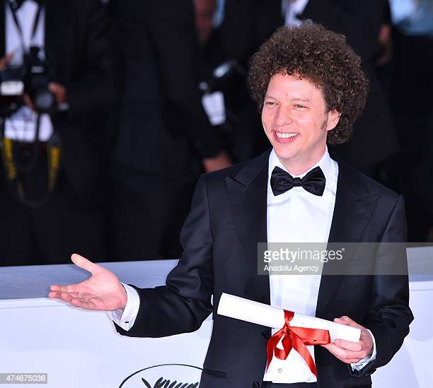 Mexican director Michel Franco poses after he received the Best Screenplay award for the film 'Chronic' during the Award Winners photocall at the...