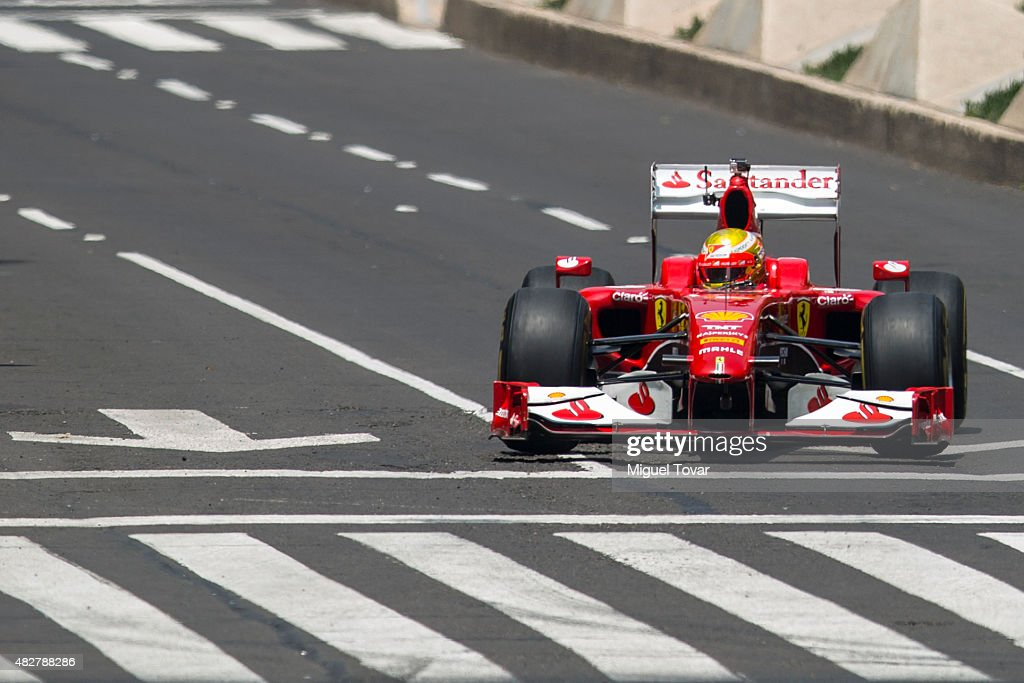 Mexican driver of F1 Esteban Gutierrez drives during the Scuderia Ferrari Street Demo at Reforma Avenue on August 02, 2015 in Mexico City, Mexico.