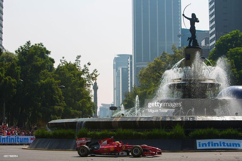 Mexican driver of F1 Esteban Gutierrez drives during the Scuderia Ferrari Street Demo at Reforma Avenue on August 02, 2015 in Mexico City, Mexico.
