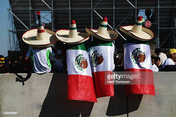Mexican fans attend the race to support Sergio Perez of Mexico and Sauber F1 during qualifying for the United States Formula One Grand Prix at the...