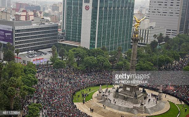 Mexican fans celebrate after the Mexico vs Croatia FIFA World Cup football match in the streets of Mexico City on June 23 2014 Mexico won by 31 and...