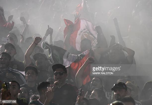 Mexican fans celebrate after winning 32 in extra time during their 2015 CONCACAF Cup against the US at the Rose Bowl in Pasadena California on...