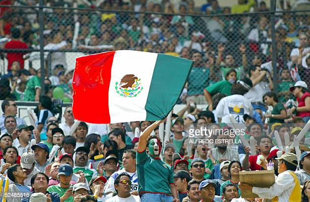 Mexican fans cheer their national team 27 March 2005 during a FIFA World Cup Germany 2006 South American qualifying match against the Unites States...