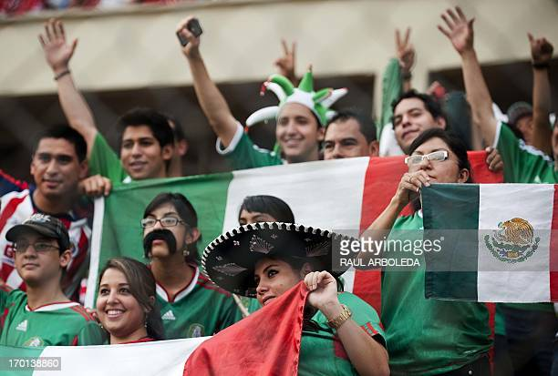 Mexican fans cheer their team before the FIFA World Cup Brazil 2014 qualifier football match between Panama and Mexico at the Rommel Fernandez...