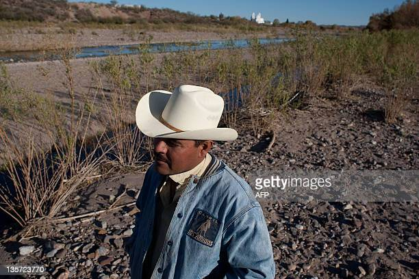 Mexican farmer Ever Mendoza walks in his ranch in Satevo Chihuahua state on December 5 2011 Dry conditions have claimed more than two million acres...