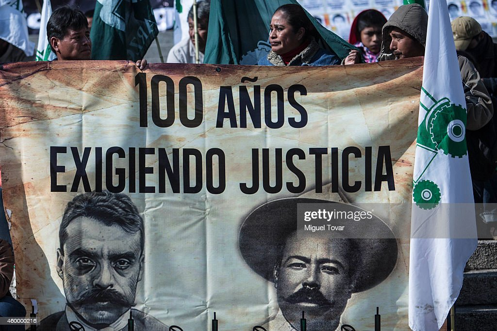 Mexican farmers hold a banner with faces of <a gi-track='captionPersonalityLinkClicked' href=/galleries/search?phrase=Emiliano+Zapata&family=editorial&specificpeople=743817 ng-click='$event.stopPropagation()'>Emiliano Zapata</a> and <a gi-track='captionPersonalityLinkClicked' href=/galleries/search?phrase=Pancho+Villa&family=editorial&specificpeople=228528 ng-click='$event.stopPropagation()'>Pancho Villa</a> during a protest by Agricultural Organizations to demand justice for the 43 missing students from Ayotzinapa at Reforma Avenue on December 05, 2014 in Mexico City, Mexico.