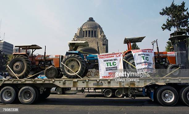 Mexican farmers' tractors are brought to Revolution Square in Mexico City 30 January 2008 as hundreds of maize producers rally to participate in a...