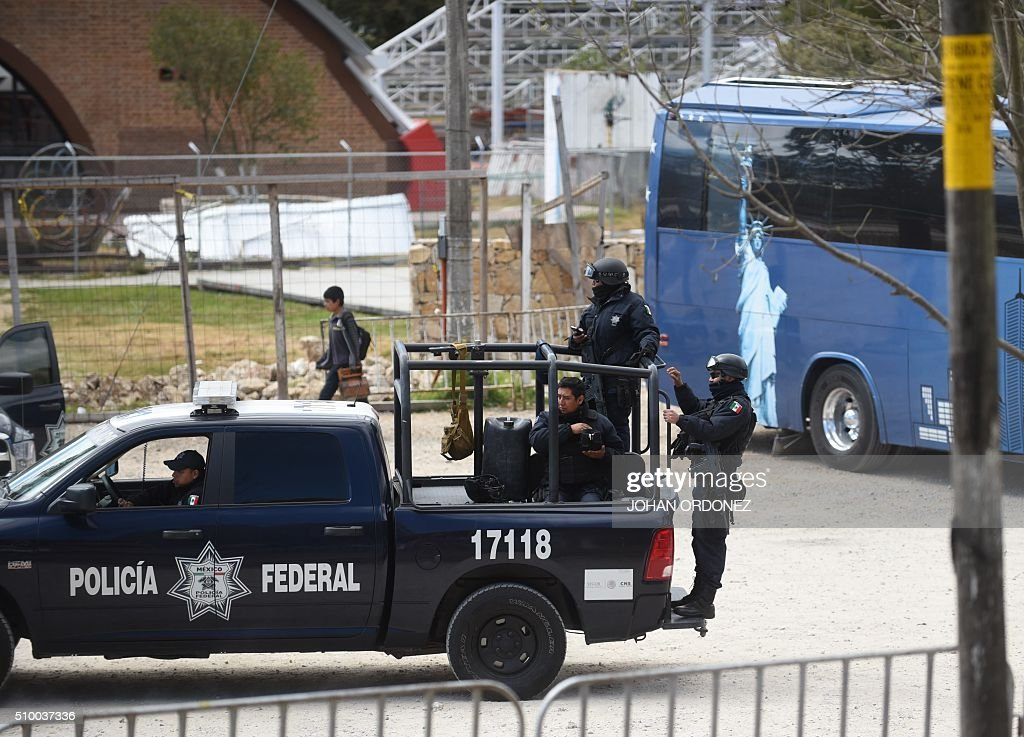 Mexican Federal Polic personnel patrol in the vicinity of the place where Pope Francis will officiate an open-air mass in San Cristobal de las Casas, Chiapas State, Mexico on February 13, 2016. ope Francis urged Mexican bishops Saturday to take on drug trafficking with 'prophetic courage,' warning that it represents a moral challenge to society and the church. AFP PHOTO/Johan ORDONEZ / AFP / JOHAN ORDONEZ