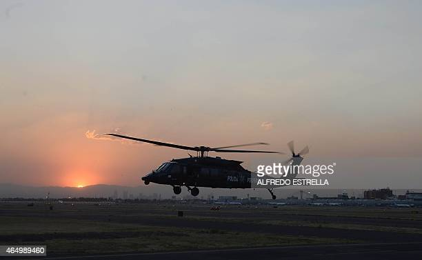 Mexican federal police Blackhawk helicopter arrives in Mexico City on March 2 2015 Mexican police captured Knights Templar drug cartel's leader...