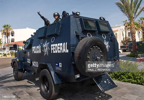 A Mexican Federal Police Officer on duty atop an armored personel carrier on June 12 in San Jose del Cabo Baja California Mexico There are 1000's of...