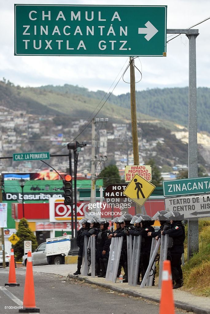 Mexican Federal Police personnel in riot gear stand by in a checkpoint at the entrance of the village of Zinacantan, in the surroundings of the place where Pope Francis will officiate an open-air mass, Chiapas State, Mexico on February 13, 2016. Pope Francis urged Mexican bishops Saturday to take on drug trafficking with 'prophetic courage,' warning that it represents a moral challenge to society and the church. AFP PHOTO/Johan ORDONEZ / AFP / JOHAN ORDONEZ