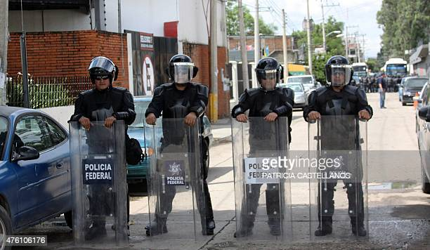 Mexican Federal policemen patrol the streets in Oaxaca city Mexico on June 6 on the eve of legislative and local elections Mexico deployed police...