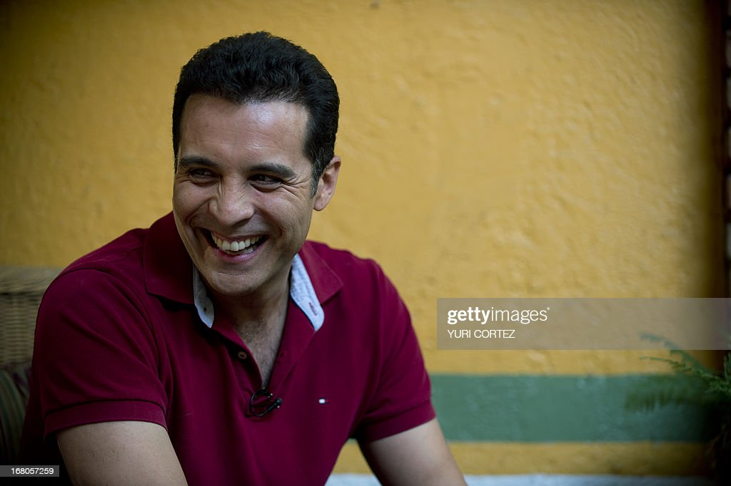 Mexican Felipe Najera, a gay soap opera actor, laughs during an interview with AFP on April 29, 2013 in Mexico City. After their marriage, Najera and Jaime Morales -a theatre producer- became the first gay couple to which the Mexican State committed a minor for adoption. AFP PHOTO/ Yuri CORTEZ