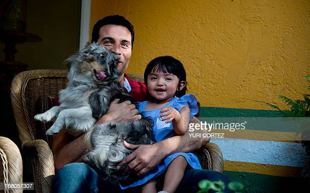 Mexican Felipe Najera a gay soap opera actor remains in the garden of his house with his adopted daughter and their pet on April 29 2013 in Mexico...