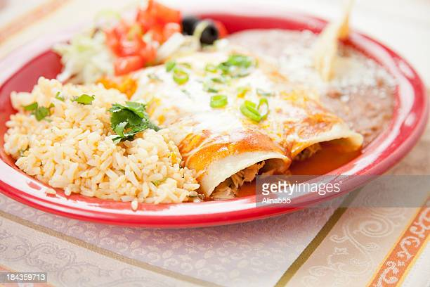 Mexican food: plate with beef enchiladas, rice and refried beans