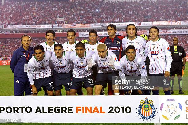 Mexican football team players of Chivas pose before the Libertadores Cup final match against Brazilian Internacional at Beira Rio stadium in Porto...