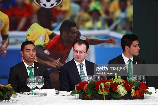 Mexican footballer Marco Fabian de la Mora Luis Videgaray the Secretary of Finance and Public Credit and Mexican footballer Diego Reyes during the...