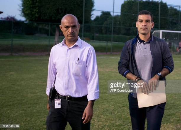 Mexican former FC Barcelona star Rafael Marquez is escorted by a security guard after a press conference in Guadalajara Mexico on August 9 2017...