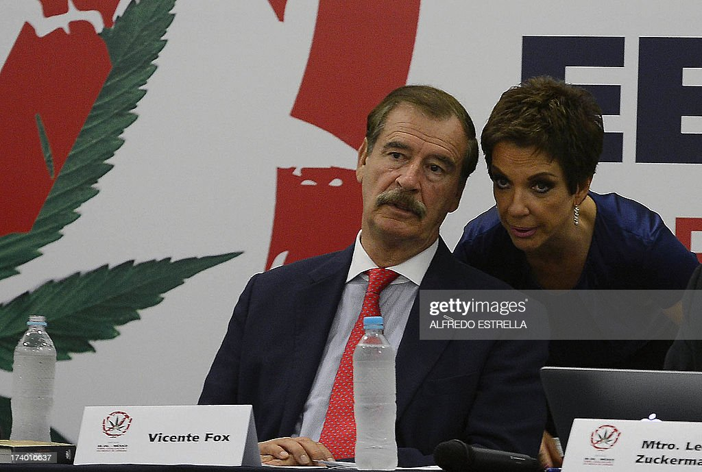Mexican former President (2000-2006) Vicente Fox (L) speaks with his wife Martha Sahagub during the opening of the US-MEXICO symposium on legalization and medical use of cannabis, at the Fox Center in Guanajuato State, Mexico, on July 19, 2013. AFP PHOTO/Alfredo Estrella