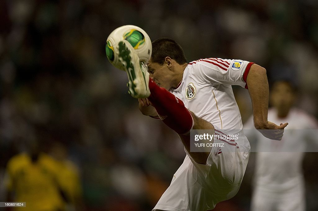 Mexican forward Javier Hernandez kicks the ball during their their Brazil-2014 FIFA World Cup CONCACAF football qualifier match against Jamaica at the Azteca stadium in Mexico City, on February 6, 2013.
