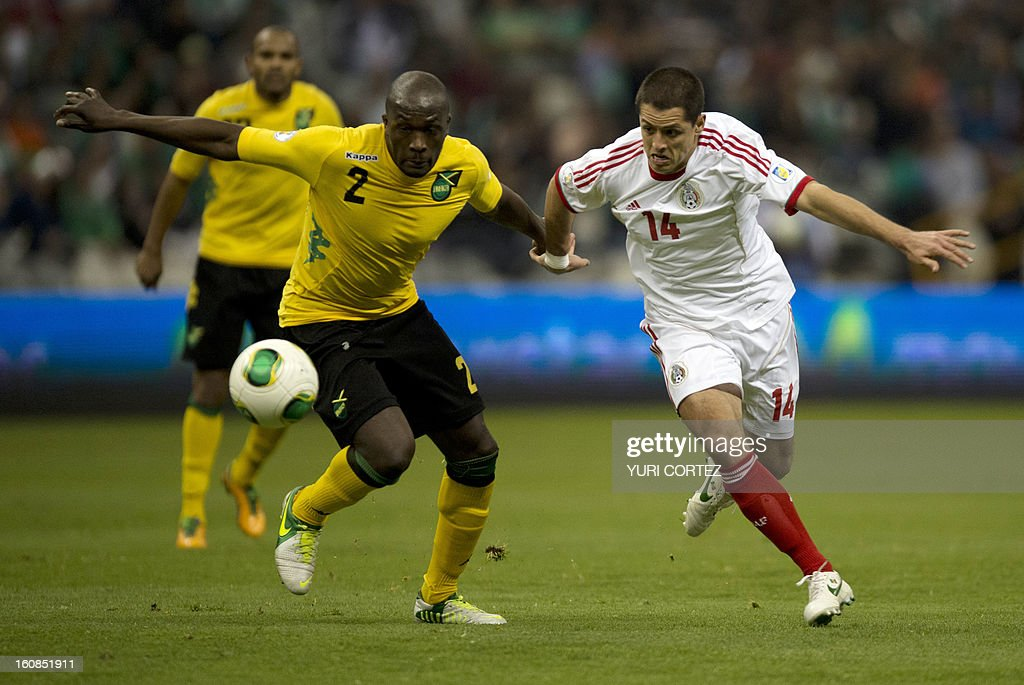 Mexican forward Javier Hernandez (R) vies for the ball with Jamaica's Nyron Nosworthy (L) during their their Brazil-2014 FIFA World Cup CONCACAF football qualifier match at the Azteca stadium in Mexico City, on February 6, 2013.