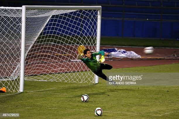 Mexican goalkeeper Guillermo Ochoa takes part in a field recognition at the Olimpico Metropolitano stadium in San Pedro Sula 240 km north of...
