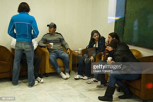 Mexican goalkeeper Guillermo Ochoa talks to relatives and friends of Paraguayan footballer Salvador Cabañas his teammate in the club America at the...