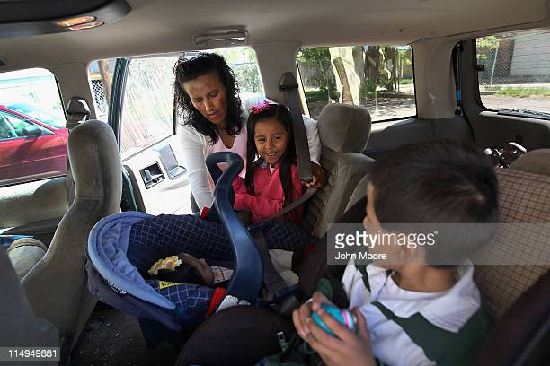 Mexican immigrant Jeanette Vizguerra loads her children into her car after a meeting at the Mexican consulate in her fight against deportation...