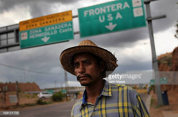 Mexican immigrant Luis Manuel walks along the US Mexico border after being deported from Arizona to Nogales Mexico on July 27 2010 in Nogales Mexico...