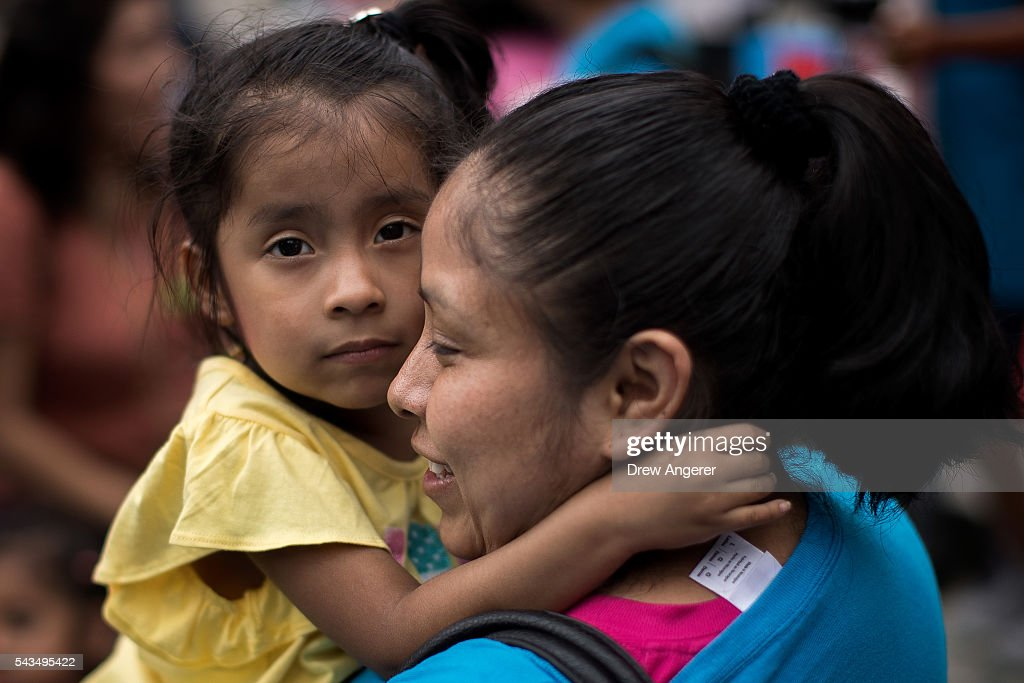 Mexican immigrant Nieves Ojendiz holds her 4-year old daughter Jane as she attends an immigration reform rally with members and supporters of the New York Immigration Coalition, June 28, 2016 in New York City, New York. Last week the U.S. Supreme Court deadlocked in a 4-4 decision concerning President Barack ObamaÕs immigration plan, which would have protected millions of undocumented immigrants from being deported. Because the Supreme Court was split, a 2015 lower-court ruling invalidating ObamaÕs executive action will stand.