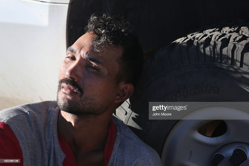 A Mexican immigrant rests against a U.S. Border Patrol vehicle after his group was caught while crossing into the United States on March 6, 2013 near Walker Canyon, Arizona. Due to broad federal sequestration budget cuts, Border Patrol agents are expected to begin taking unpaid furlough days in April, as Customs and Border Protection funding is expected to be reduced by more than $500 million.
