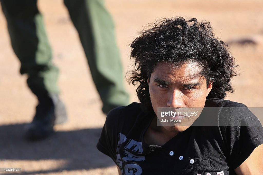 A Mexican immigrant sits under U.S. Border Patrol supervision after his group was caught while crossing into the United States on March 6, 2013 near Walker Canyon, Arizona. Due to broad federal sequestration budget cuts, Border Patrol agents are expected to begin taking unpaid furlough days in April, as Customs and Border Protection funding is expected to be reduced by more than $500 million.